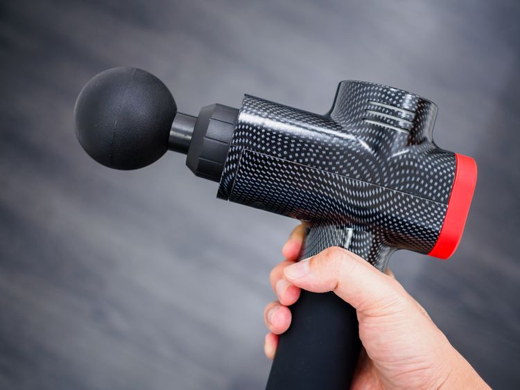 Čierna masážna pištoľ